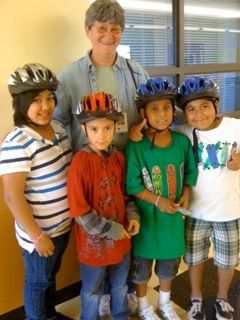 Jose (in green) and helmeted friends with Nancy Nelson, WashCo BTC volunteer.